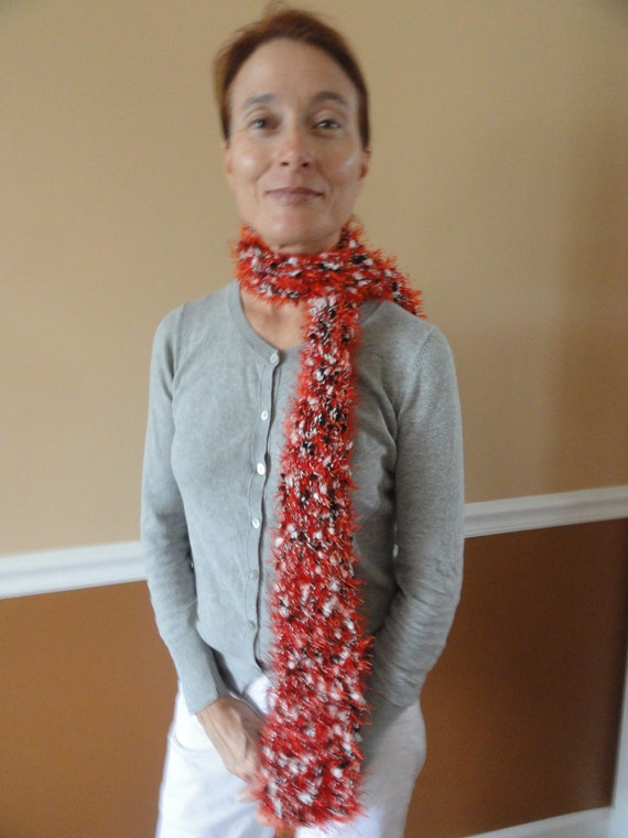 red with black and white pompons scarf