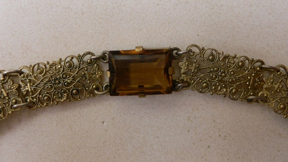 Vintage gilded pressed filigree panel Bracelet with rectangular Topaz colored glass Stone