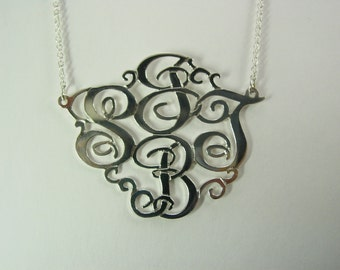 "monogram necklace. 1.5""  size with  4 initials-sterling silver monogram. with a chain."