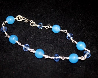 Sterling silver wire wrapped blue sapphire and blue crystal bracelet