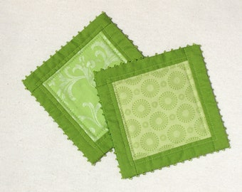 Green patchwork coasters with glass beads, quilted mug rugs