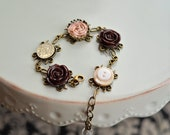 Lovely Roses Bracelet - ribbon coiled rose, baubles and more in antique brass settings