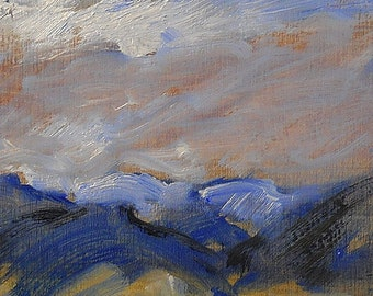Wind swept sky over mountains and prairie subject of small oil painting