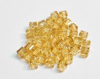 Lt Topaz Square Glass Beads 4mm