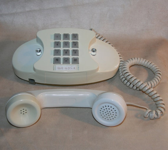 1970s Bell Princess Telephone Phone Touch tone in White has original receiver cord and a wall cord