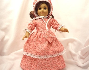 Shades of orange print, long dress for 18 inch dolls, double skirted with white lace trim.