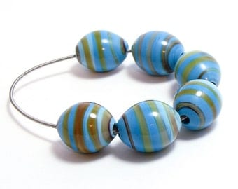 Lampwork beads oblong shades of blue with yellowish spiral set of six