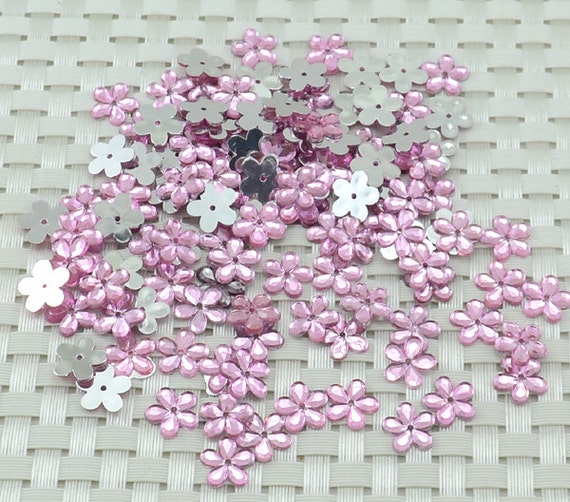 50 ea. 11.5 mm Pink  Plastic (quincunx) flower appliques