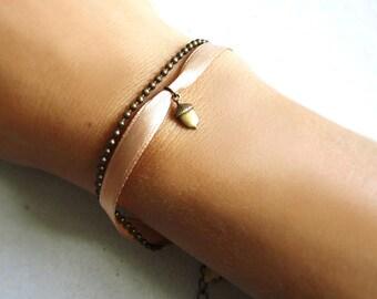 Bracelet with a tiny brass acorn and satin ribbon. Woodland bracelet