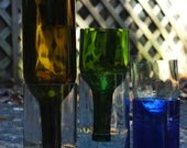 your choice, any color or size. self watering planters made from recycled wine bottles. great gift for spring flowers.