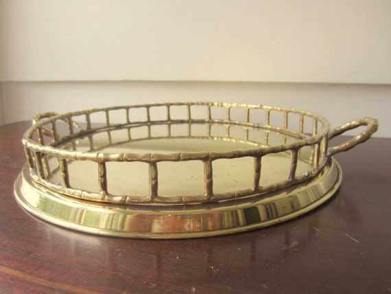 Medium round brass faux bamboo tray.  Hollywood Regency style brass bamboo tray.