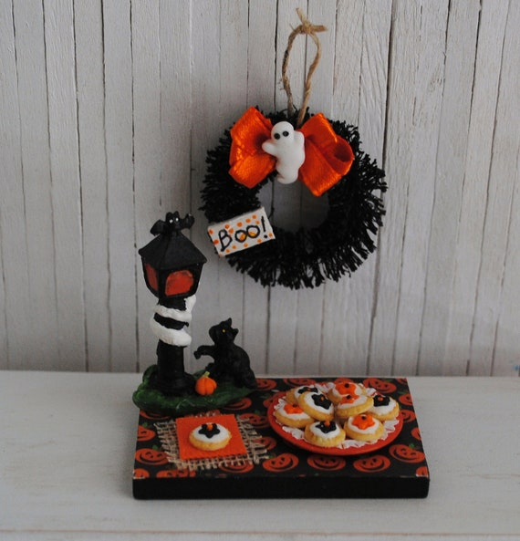 "Miniature Halloween Cookies And A Halloween Wreath With An Orange Bow, A Little White Ghost, And A Shabby ""BOO"" Sign"