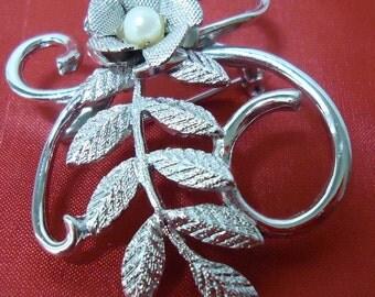 Brooch, vintage, Stamped CORO. flower with pearl center, on leaf sprig on vine. SOSVI12.3-15.3.