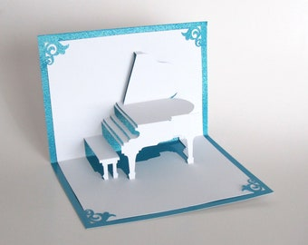 GRAND PIANO 3D Pop-Up Greeting Card Handmade Cut by Hand Origamic Architecture in White and Bright Shimmery Metallic Light Blue Turquoise.
