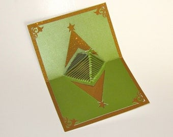Christmas Tree 3D Pop Up Greeting Card and Decoration. Handmade Cut by Hand Origamic Architecture in Forest Green and Shimmery Bright Gold