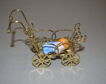 Vintage Miniature Victorian Styled Gold Colored Metal Baby Carriage with Baby Doll