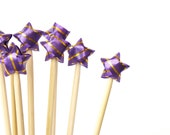Purple and gold origami stars - cake toppers