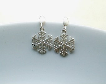 Winter sterling silver stud earrings with snowflakes