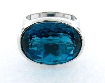 White Gold large oval faceted London Blue Topaz Horizon cocktail Ring, Large oval London Blue Topaz Ring in White Gold