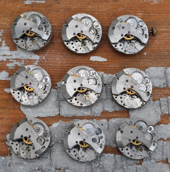 0.7 inch Set of 9 vintage watch movements.