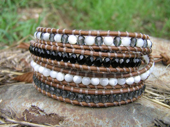 Black and Grey Faceted Glass Beads, White Opal, Four Wrap Light Brown Distressed Leather, Brass Key Charm