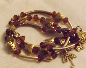 Exquisite Gold Beads with Brown Swarovski w/ Fun Charms.