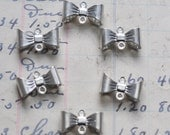 Six brass bows connectors, Sterling Silver Finish