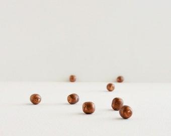 2 copper barrel balls oddity