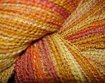 Hand Spun and Dyed Rambouillet Wool, Textured 2 ply, Gold, orange yellow, rose.  233 yards