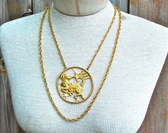 Aries zodiac necklace with stars and gold tone chain by Richelieu.