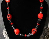 Red Howlite turquoise skull,  Hematite chip and red bamboo coral nacklace