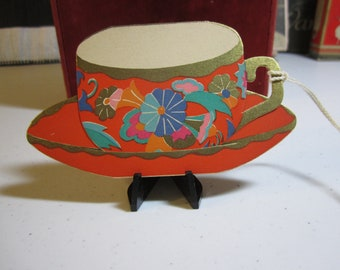 Gorgeous 1920's-30's unused art deco die cut gold gilded bridge tally in the shape of a tea cup and saucer