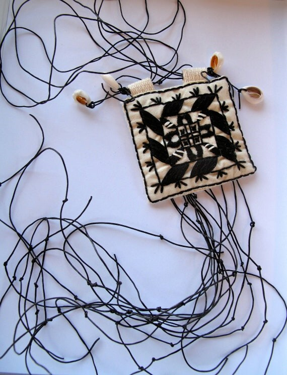 Textile necklace African inspired black and white handmade embroidered pendant with long leather fringe cowrie shells