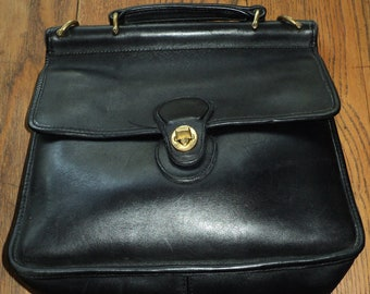 Vintage Coach Black Leather Saddle Bag Style Purse with solid brass accents in Great Condition, however it is missing the shoulder strap