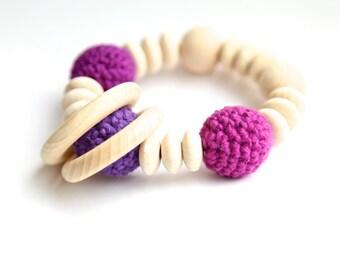 Purple and lilac nursing bracelet. Teething ring rattle toy.