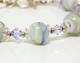 Beaded Bracelet of Beautiful Lampwork OOAK Blue and White Swirl Beads with touches of Pink and Yellow