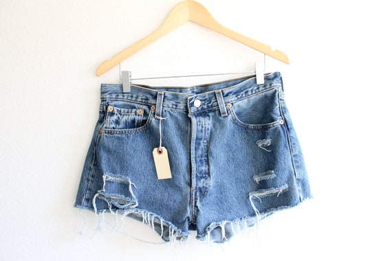 "Waist: 34""  Vintage Distressed High Waisted Levi Shorts"