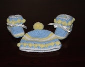 RESERVED - Baby Booties and Matching Hat - Crocheted Blue - Yellow Pom Pom Trim with White Satin Bow. Newborn to 3 months size.