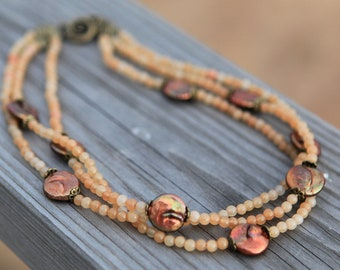 Handmade choker Necklace with three strings of Copper Coin Pearls and little agate stone beads.