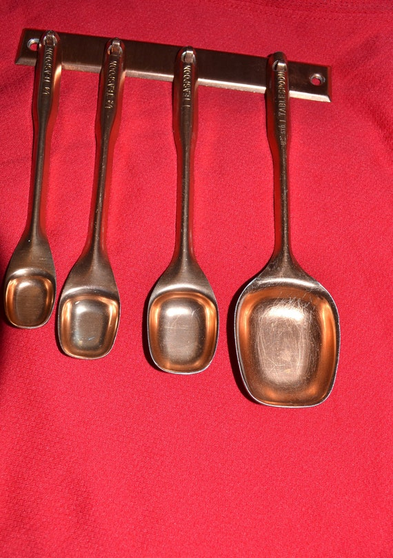 vintage brass measuring spoons