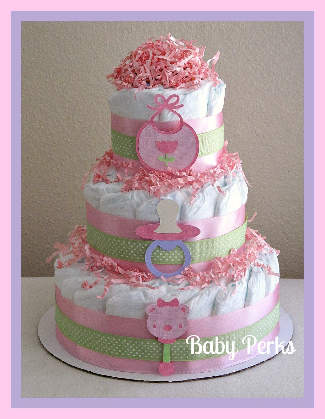 Baby girl diaper cake pink and purple baby shower for Baby shower decoration diaper cake