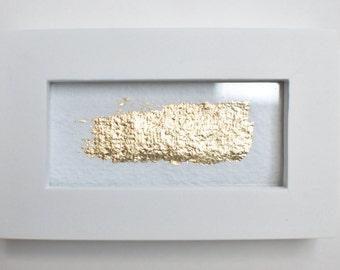 Golden stripe on  white paper