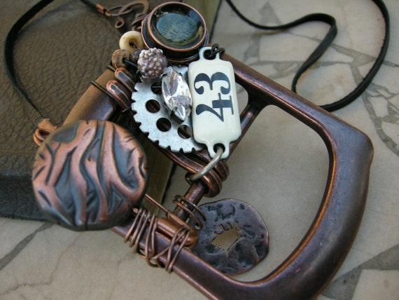 Wire Wrapped Belt Buckle Necklace with Vintage Wedding Cake Bead and Steam Punk Charms
