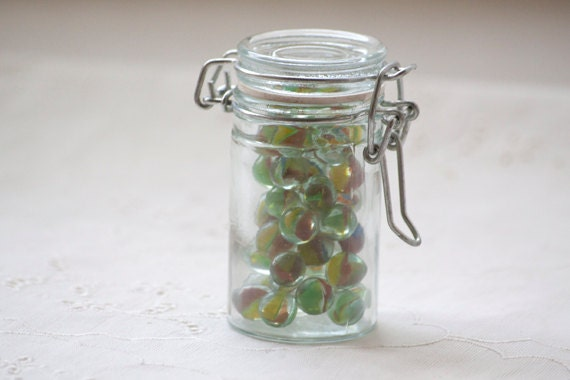 Small Glass Jar with Bail Clamp Filled With Vintage Mini Peewee Cats Eye Marbles