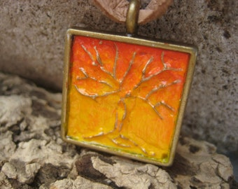 Bronze 3D Tree with a Graded Yellow and Red Sunset