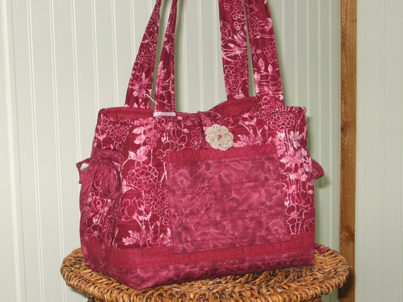Handmade large quilted tote purse handbag in shades of crimson, cranberry with hints of white in flowers and leaves, marbled print
