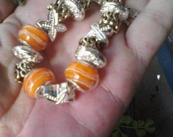 Orange and gold, Euro style bracelet