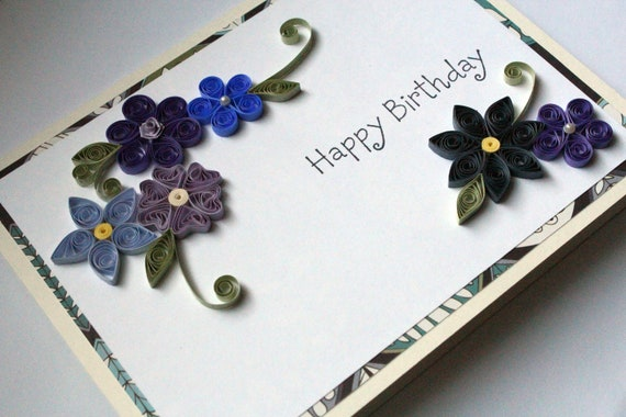 Handmade birthday card with blue and purple paper quilled flowers