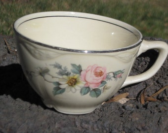 Vintage Tea Cup,China Cup with Pretty Pink,White Flower,Yellow Center/Pretty Green Leaves/ Pretty No Markings :)Not Included in Coupon Sale