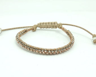 Champagne crystal wrapped cotton bracelet.